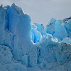 The intense blue colour seen in glacial ice is often wrongly attributed to Rayleigh scattering. Rather, ice is blue for the same reason water is blue: it is a result of an overtone of an oxygen-hydrogen (O-H) bond stretch in water which absorbs light at the red end of the visible spectrum.