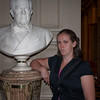 Sasha puts on her serious face while posing with a statue for a general.