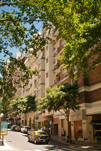 My apartment building from the corner of Ayacucho and Posada street, in Recoleta, Buenas Aires. I am in the topmost (7th) floor with the greenhouse type windows. My apt looks like it juts out away from the others.