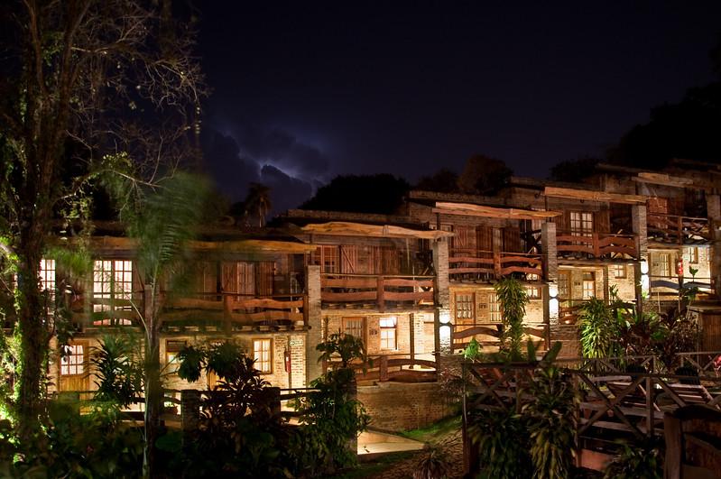 Los Troncos at night during a lightning storm in Puerto Iguazu.