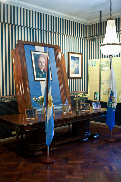 "Evita's office, where she lay in state for two years before the Argentine military ""kidnapped"" her corpse. They shuffled it around Buenos Aires for 16 years before secretly entombing it in Milan, Italy. It was discovered and returned to Argentina, to Juan Peron's dining room table to be exact. Story goes he even got his current wife to lie next to Evita so she could absorb the good vibes. <br /> <br /> I'm tellin' ya, you can't make this stuff up."