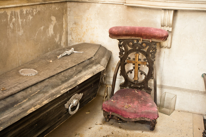 Recoleta Cementery. This tomb has seen better days. Looks like the legs of the chair just rotted off.