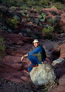Gary seated on a rock in the desert near Phoenix, Arizona - 1986-87