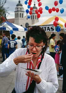 Rita eating Thai stick - street festival - Phoenix Arizona, 1987.