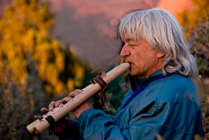 Omega playing the flute at sunset in Sedona
