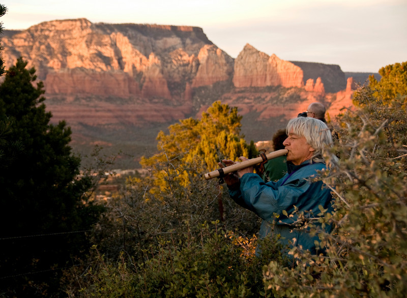 While up at Airport Mesa in Sedona to watch the sunset, I heard a flute playing and looked around the bushes to see Omega playing the flute.
