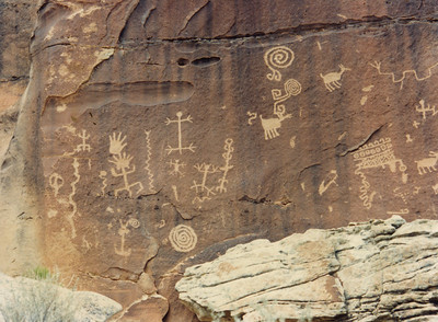 Zuni Rock Art, Zuni Petroglyphs and Zuni Pictographs  These petroglyphs are on a sandstone overhang near an ancient site known as Village of the Great Kivas on the Zuni Pueblo.