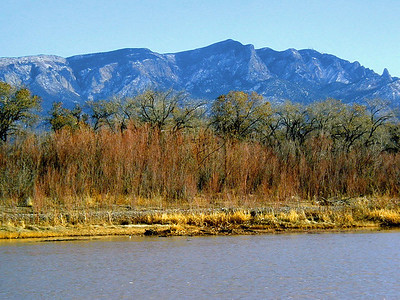 Winter, Sandia Mountains with the Rio Grande in the foreground  Albuquerque is in Central New Mexico  Southwest United States