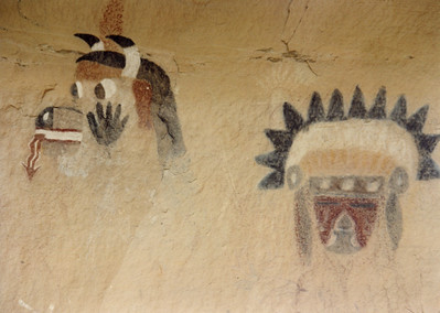 Zuni Rock Art, Zuni Petroglyphs and Zuni Pictographs  On the left is Wakashi, the Cow kachina  These pictographs are on a sandstone overhang near an ancient site known as Village of the Great Kivas on the Zuni Pueblo.