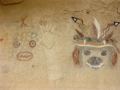Zuni Rock Art, Zuni Petroglyphs and Zuni Pictographs  The kachina on the right is Wo'latana, the Bear. These pictographs are on a sandstone overhang near an ancient site known as Village of the Great Kivas on the Zuni Pueblo.