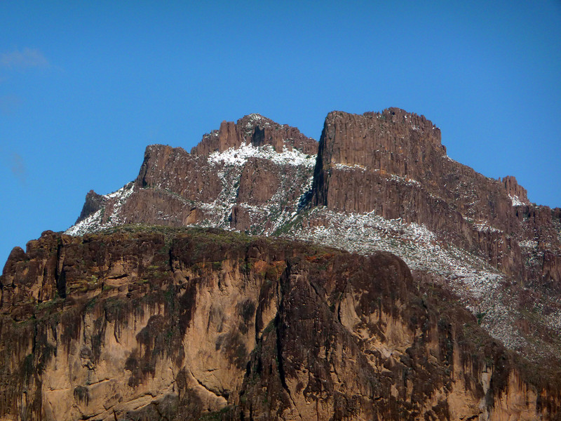 A late dusting of snow on the Superstitions on 3/18/2012. The dark spot at the top is where the plane crashed on November 23, 2011.