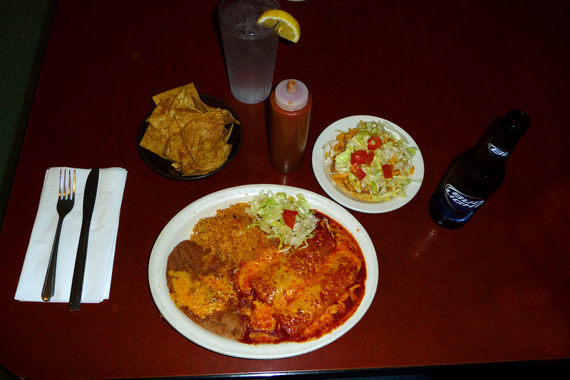The #3 at Los Hermanos, 2-enchilatas, beans, rice, a tostata, chips and salsa all for $7, beer is extra.