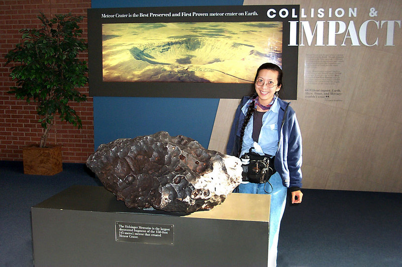 Helen with a piece of the meteorite that formed the crater. The meteorite was 150 feet across.