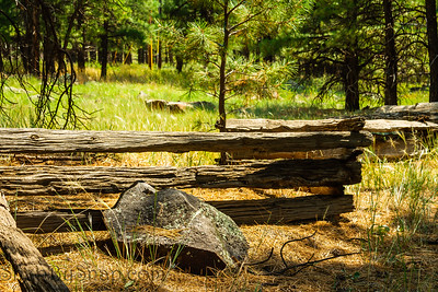 A zigzag fence made from old lumber