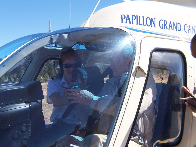 "Ready for takeoff. My Dad gets his instructions as ""co-pilot"" for our helicopter ride over Grand Canyon. What a view!"
