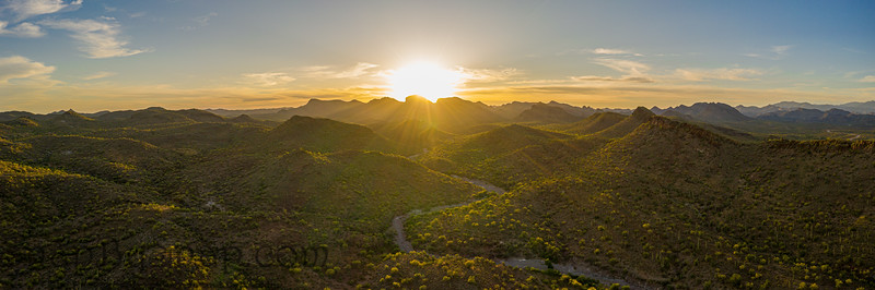 Aerial panorama over the Arizona desert during sunset with mountains