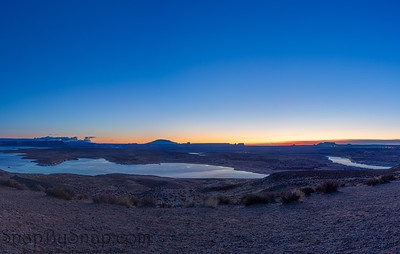 Panoramic image of the morning sky with Lake Powell in the foreground