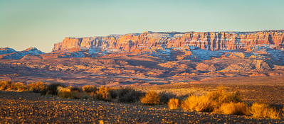 Panorama image of the morning light striking the cliffs of Vermilion Cliffs National Monument