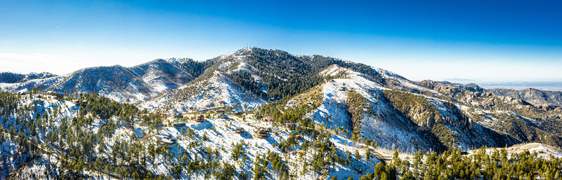 A panorama aerial image of the summit of Mt. Lemmon outside of Tucson, Arizona covered in snow