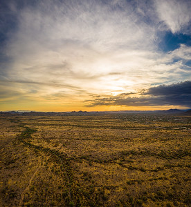 A vertical panorama of a sunset over the Sonoran Desert