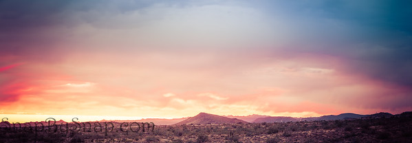 A dramatic cloudy panorama sunset in the desert of Arizona