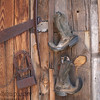 Some old boots on the wall in Tonto National Forest in Arizona.