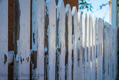 An old white picket fence