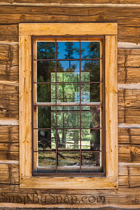 An old window on a rustic cabin
