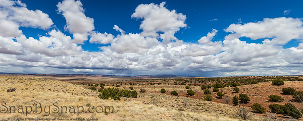 A panorama looking over the desert of northern Arizona with the Vermillion cliffs in the distance