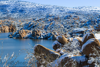 Winter at Watson Lake in Prescott Arizona with the Granite Dells and a blue sky