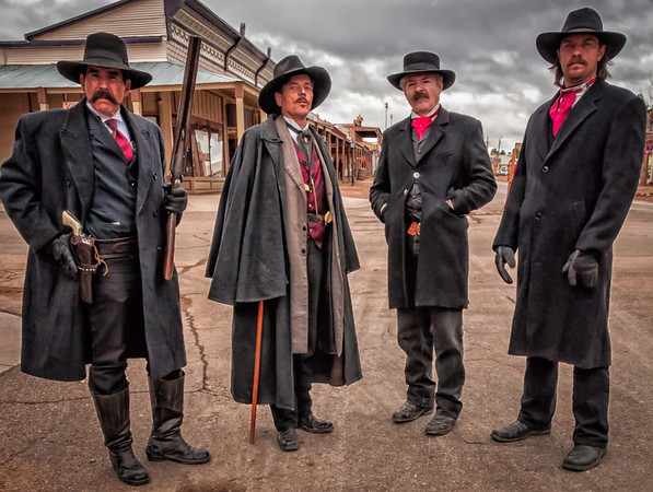 The Earp brothers and Doc Holliday gather before the afternoon re-enactment of the gunfight at the OK Corral.  Tombstone, AZ.