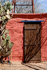 Door on old adobe outbuilding in desert southwest USA.