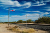 Lone beer sign still stands next to the railroad tracks in southern Arizona even though the bar is long gone.  After revisiting this spot south of Tucson I have found even the sign and pole is gone now.  I hope the sign at least made it into some antique shop!