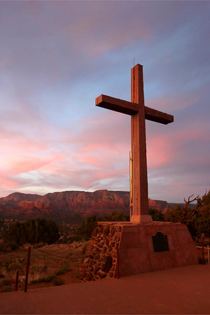 On top of Airport Mesa.  Masonic Temple Cross overlooking the red rocks at sunset.