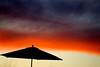 Umbrella against sunset sky