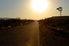 Arizona road looking west at sundown.