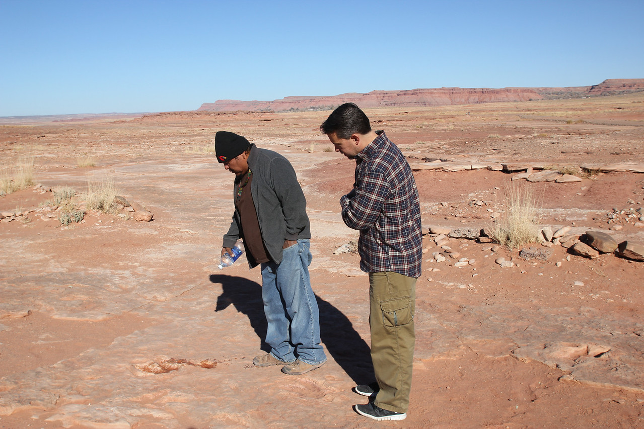 Dinosaur Tracks - Near Tuba City, our Native American guide is squirting water onto the tracks to help them stand out.