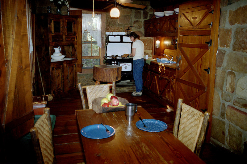 Rita in the kitchen; cabin at Tanyard Springs, near Petit Jean, Arkansas.