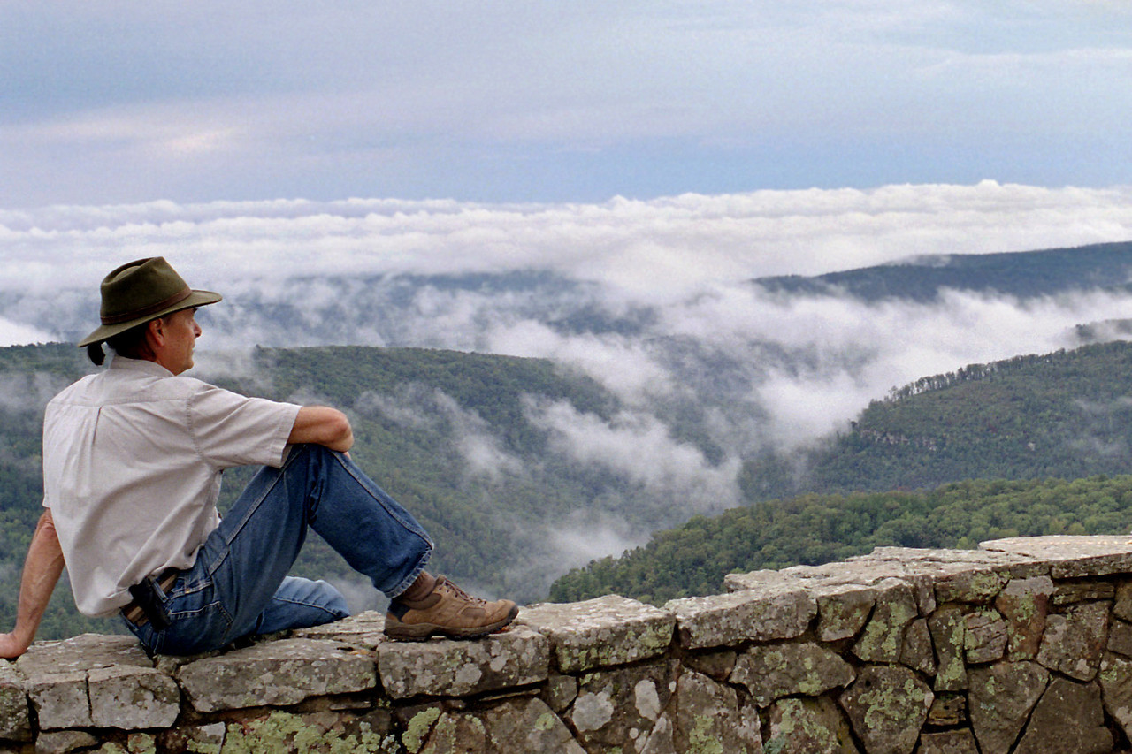 Fog on the mountains - Gary taking in the view from the rim trail, White Rock Mountain, Arkansas. October, 2007