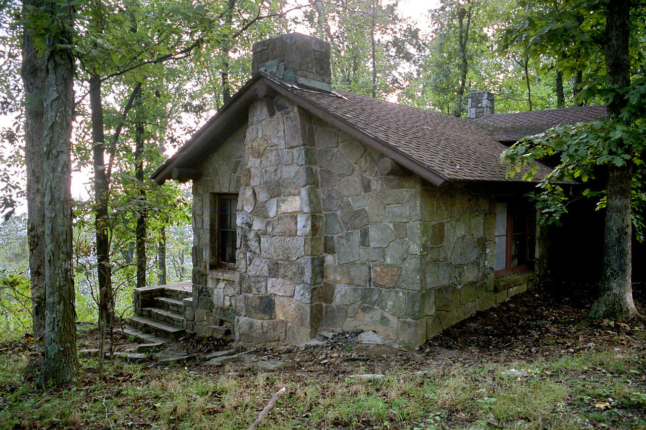 Cabin, White Rock Mountain, Arkansas. <br /> <br /> The CCC era cabin is owned by the U.S Forest Service, but rentals are handled by a 3rd party private concessionaire. Dodgy.