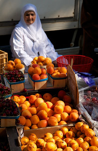 Arles Market Lady selling her oranges and cherries