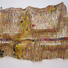 High Museum<br /> <br /> Artist Name: El Anatsui<br /> Nationality & Life Dates: Ghanaian, born 1944<br /> Title: Taago<br /> Date: 2006<br /> Medium: Aluminum and copper wire<br /> Dimensions: 82 x 124 inches<br /> Accession Number: 2007.1<br /> <br /> Credit Line: Purchase with funds from the Fred and Rita Richman Special Initiatives Endowment Fund for African Art and Joan N. Whitcomb