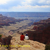 People sit at the edge of a rock enjoying the view at Grand Canyon north