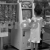 Black and white version of Girl playing video game: Nagasaki, Japan.