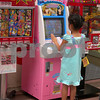 Video games are not just for boys! This has you playing taiko drums. Nagasaki, Japan