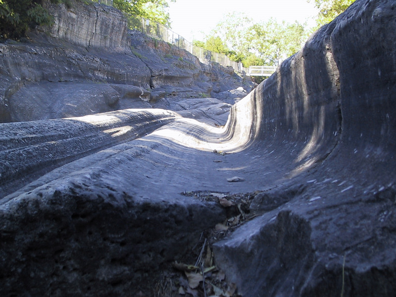 """At the north end of the island, near the entrance to <a href=""""http://www.dnr.state.oh.us/parks/parks/lakeerie.htm"""">Kelleys Island State Park</a>, are these glacial grooves."""