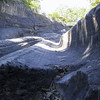 "At the north end of the island, near the entrance to <a href=""http://www.dnr.state.oh.us/parks/parks/lakeerie.htm"">Kelleys Island State Park</a>, are these glacial grooves."