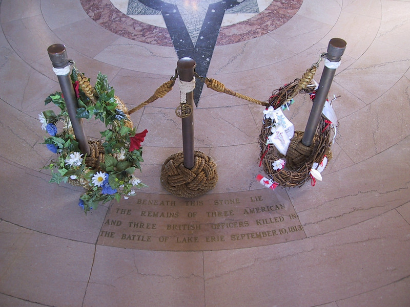 """""""Beneath this stone lie the remains of three American and three British officers killed in the Battle of Lake Erie September 10, 1813"""""""