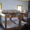 Bunks in the barracks.  The upper bunks show how they were stored during the day.