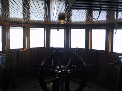 The pilothouse of the ore/car carrier Canopus, built in 1905, and now part of the museum.  The windows look out over the lake.